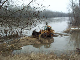 Mankato district, front loader in water