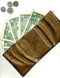 Wallet with dollar bills, coins protruding
