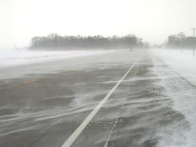 Snow blowing across highway