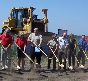 Jim Swanson, Mankato district engineer (third from left) joined business leaders, law enforcement agents and elected officials in the official groundbreaking for the reconstruction of Hwy 14 around Waseca. Photo by Rebecca Arndt