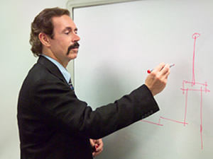 Scott Bradley writing on white board