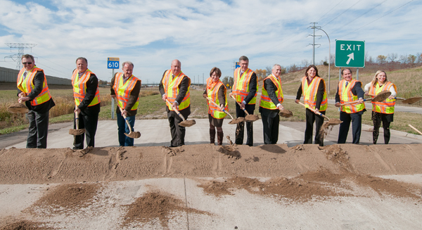 Photo of local and state leaders at Hwy 610 groundbreaking.