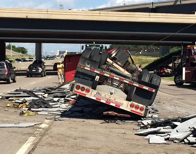Photo of a semi rollover.