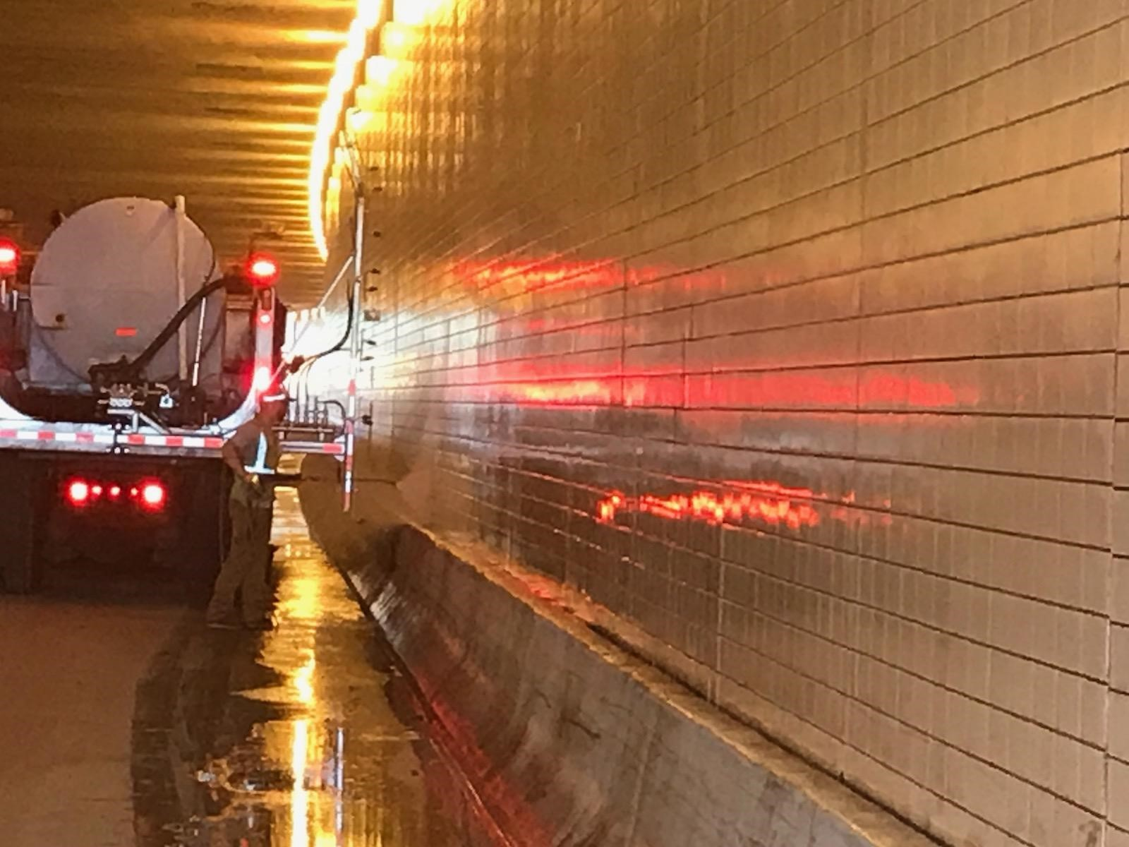 Photo: a truck in a tunnel spraying water at a tunnel wall
